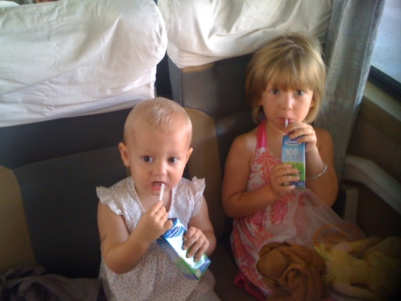 On a real train. Drinking milk.  Butter wouldn't melt...