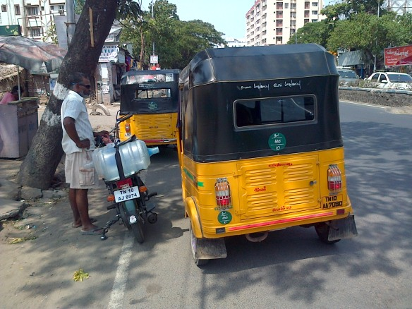The unmistakable yellow and black Indian tuk-tuks (air-con not provided)