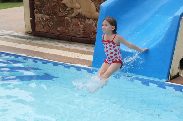 Flo on her 100th trip down the hotel pool's waterslide