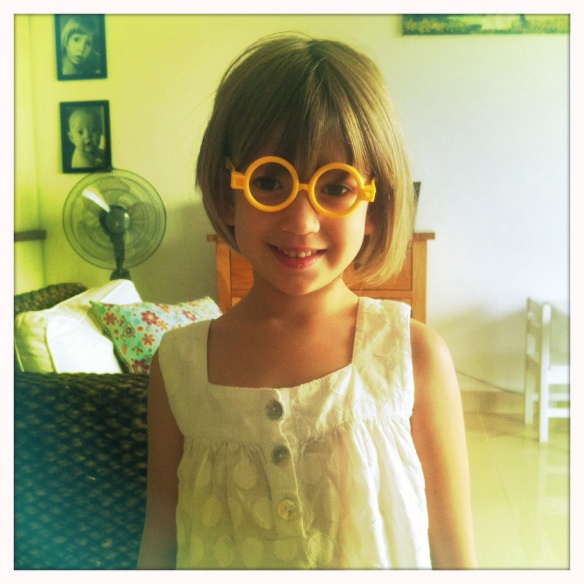 Flo wearing Martha's new doctor's glasses (a Tet present)