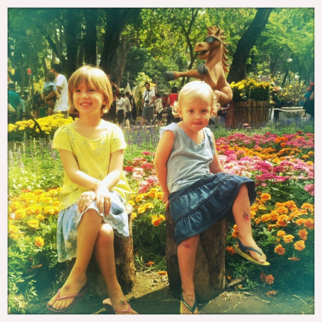 Girls posing in front of Tet flowers
